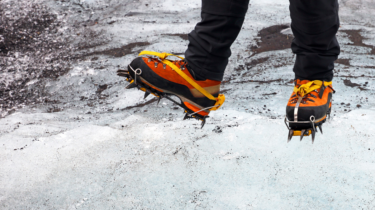Shoes-with-Crampons---Hiking-on-Glacier-iStock-JurgaR-www.istockphoto