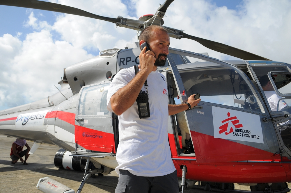 : Logistician in front of helicopter chartered by MSF for the emergency response after typhoon Haiyan swept over the Philippines.