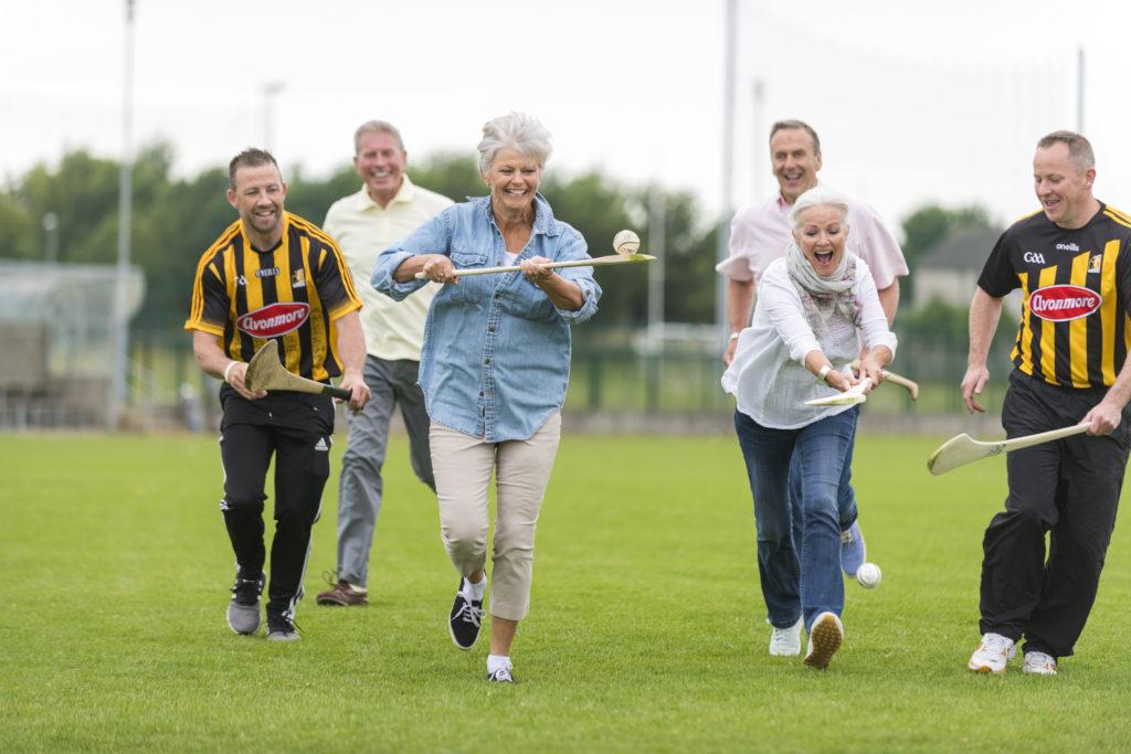 Insight Vacations guest enjoying a hurling lesson - an ancient Irish sport